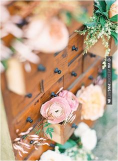 Awesome! - florals in card catalog drawers | CHECK OUT MORE GREAT VINTAGE WEDDING IDEAS AT WEDDINGPINS.NET | #weddings #vintagewedding #weddingvintage #oldweddingphotos #events #forweddings #iloveweddings #romance #vintage #planners #old #ceremonyphotos #weddingphotos #weddingpictures