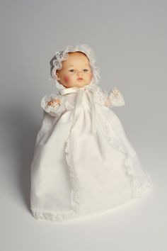 minus the white dress... this looks like my Blue Baby. She was the doll I carried EVERYWHERE!