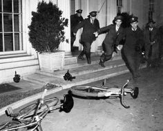 Bike messengers leave the White House after the attack on Pearl Harbor. December 7, 1941.
