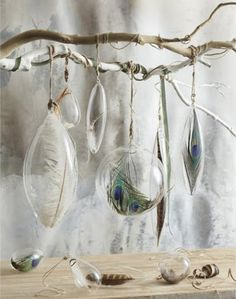Driftwood for water and meandering lines... glass ornaments could be filled with shells, sea glass, sand or black stones
