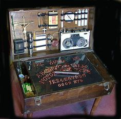 A ghost hunting suitcase table- pretty cool! Werewolf Hunter, Vampire Hunter, Wiccan, Witchcraft, Magick, Holidays Halloween, Halloween Decorations, Voodoo, Ghost Hunters