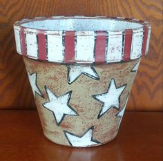 Check out this item in my Etsy shop https://www.etsy.com/listing/272416686/hand-painted-terracotta-pot-with-stars