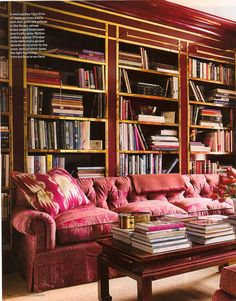 Brass trimmed bookshelves in high gloss red, ming coffee table, tufted sofa...Not a thing I would change. Albert Hadley.