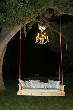 I must hang my wicker swing from the big maple tree. Like the chandelier, too..