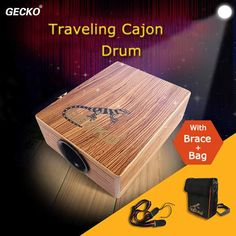 GECKO Traveling Cajon Drum Boxing Percussion With Braces Bag Specification:    – Brand: GECKO  – Size: 95*230*290mm  – Color: natural brown  – Material: zebra wood  – Structure:inner string sound  – Finish: environmental...