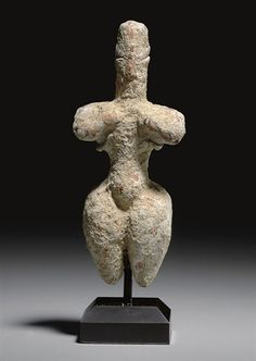 A GREEK TERRACOTTA STEATOPYGOUS FIGURE NEOLITHIC PERIOD, THESSALY, CIRCA 6TH MILLENNIUM B.C.