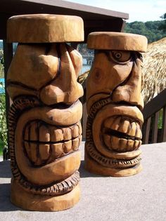 Chainsaw carved tiki bar stools carved by Brett McLain in Sample Work by Freehand Custom Carvings