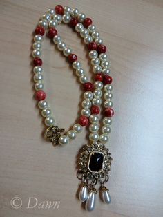 My second attempt at a necklace for my Italian Renaissance costume - pearls & coral for the necklace, and a heavily altered box clasp made up the pendant. More photos and how I made/altered it on my blog. https://dawnsdressdiary.wordpress.com/2015/02/18/1480s-florence-my-costume-jewellery/