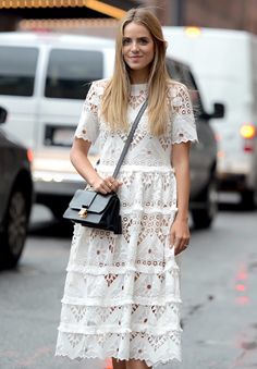 Julia Engel of Gal Meets Glam wearing one Alexis lace number on the streets in New York.