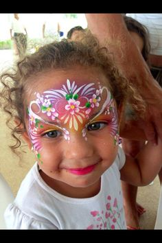 Now THIS is beautiful!  I like the background and how the flowers are incorporated into the design!  Fast Face painting for girls