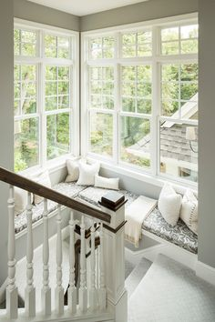 transitional staircase .. using the litte extra space on one of the landings the created a window seat.