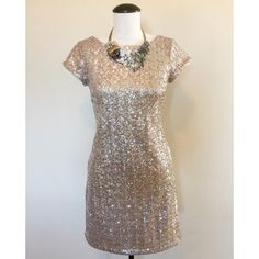 "WHBM Sequin (Gold) Cap Sleeve Dress sz XS White House Black Market Sequin (Gold) Cap Sleeve Dress sz XS ✨ This item is a ""re-posh,"" it just didn't quite fit me right but it is in great condition. The tag says it's an XXS but fits more like and XS (that's why I have it listed as an XS). It has a zipper in the back and cap sleeves. The necklace is NOT included.                                         NO TRADES NO PAYPAL White House Black Market Dresses Mini"