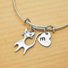 A personal favorite from my Etsy shop https://www.etsy.com/ca/listing/217861606/cat-bangle-sterling-silver-bangle-cat