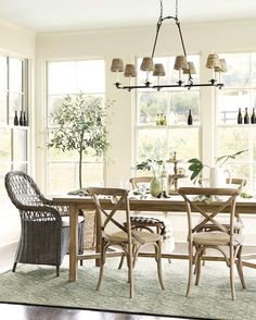 Woven dining chairs, mixed with our ever-popular Constance Side Chair, invite a laid-back vibe into this open dining area Decor, Furniture, Beautiful Dining Rooms, Dining Room Decor, Dining Room Inspiration, Wicker Dining Chairs, Rustic Dining Room, Dining Room Furniture, Neutral Dining Room