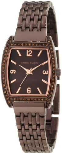 Anne Klein Women's 10/9727BMBN Swarovski Crystal Accented Brown Ion-Plated Bracelet Watch Anne Klein. $69.97. 60 topaz colored swarovski crystals set in the bezel. Brown colored mother-of-pearl dial with rosegold-tone arabic 3, 6, 9 & 12 and stick markers at all other hours. Rosegold-tone hour, minute and stick second hand. Adjustable link brown ion-plated bracelet with jewelry clasp closure and extenders. Cushion shaped, 23 mm wide brown ion-plated case with rosegold-t...