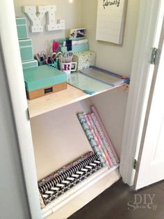 Organization Idea: wrapping paper storage utilizing angled closet floor space! Idea from MichaelsMakers DIY Show Off