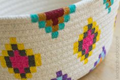 This Kilim-Inspired painted basket tutorial is an easy way to try out a fun new color palette quickly and inexpensively. It's so simple to make! Rope Basket, Basket Weaving, Fall Crafts, Diy And Crafts, Decorated Flower Pots, Craft Tutorials, Craft Ideas, Project Ideas, Craft Projects