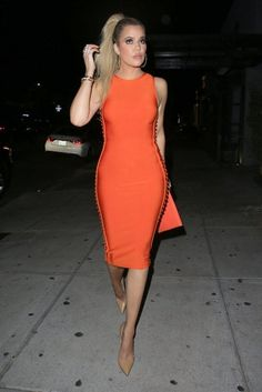 Khloe Kardashian wearing Givenchy Clutch, Christian Louboutin So Kate Pumps in Nats and House of CB Martinique Burnt Orange Side Weave Bandage Dress