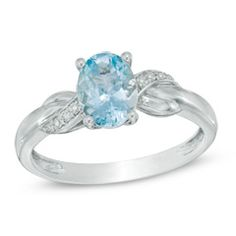 Oval Aquamarine and Diamond Accent Twist Ring in 10K White Gold