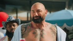Dave Bautista's inner monologue reveals that he'd like to shimmy in the sun with all of his friends, but seriously, he says aloud -- don't. Smirnoff Seltzer in hand, he says to do it for America. Vodka Drinks, Martinis, Cocktails, Sales And Marketing, Digital Marketing, Dave Bautista, Tv Adverts, Competitive Analysis, Coconut Rum