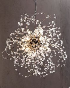 Beautiful glass chandelier in a burst looks like water being splashed and the image is frozen in time. Great way to add wow to your dining room!