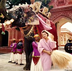 'Anne Gunning in Jaipur' by Norman Parkinson, 1956. A fine example of the vivid colours and sumptuous backdrops that characterised much of Parkinson's work, and became hallmarks of his fantastical style. Currently on display in the National Portrait Gallery's 'Vogue 100: A Century of Style' exhibition (© Norman Parkinson Ltd/Courtesy Norman Parkinson Archive)