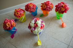Bouquets hydrating in sand buckets before the ceremony!