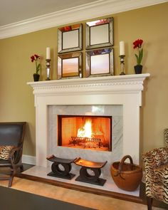 Pretty surround on fireplace...and open section is elevated...like for a bedroom