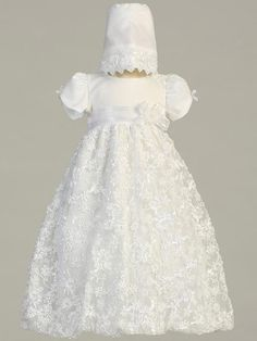 Amber Embroidered Satin Ribbon Tulle Christening Gown $64.95 This beautiful tulle Christening gown has an embroidered skirt with a floral satin ribbon pattern and a bow accent at the waist. Short puff sleeves with a dainty ribbon bow. Comes with a matching embroidered bonnet. This gown is perfect for a Baptism, Christening, Blessing or any other Special Occasion. Visit BaptismalGownsPlus.com for our full selection of Baptismal apparel for boys and girls.