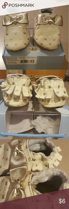Robeez infant crib shoes Size 6-12 months. In good condition overall.  The tips of the toes have some areas that rubbed off(see picture). The bottoms have some discoloration but nothing major. Still feel as though they have alot of life left. Smoke free home. Robeez Shoes Baby & Walker