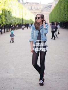 Criss-crossed checkered skirt, denim jacket, black sheer pantyhose and sneakers