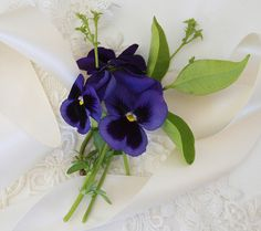 pansies nosegay instead of corsages for the mamas and grandmas