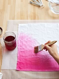 make ombre napkins by painting fabric dye onto plain cotton napkins