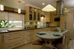 #cultivateit Contemporary Island Kitchen shows a concrete/glass-topped island and two-tone cabinetry. (Cultivate.com)