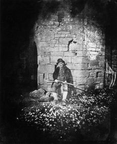 Gamekeeper sitting with daisies, c 1840s.       Salted paper print by William Henry Fox Talbot
