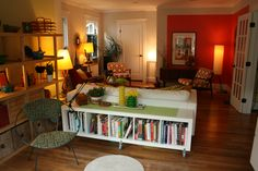 Rolling EXPEDIT as console table/bookcase behind KARLSTAD sofa: http://www.flickr.com/photos/k2yhe/5914468044/in/set-72157626005170274