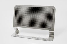 Hannes Harms, a German industrial designer and graduate from the Royal College of Art, recently completed and presented his latest design of the stylish Flat Boombox – a minimal personal audio solution consisting of a perforated sheet of acid-etched stainless steel.