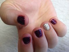 Purple with sparkles and a silver glitter accent nail Oasis Salon and Spa Mill Hall Pa (570)726-6565