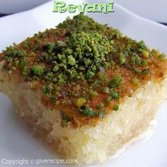 "Semolina cake soaked in sweet syrup and topped with pistachio ... in Arabic we call it ""Haressa"""