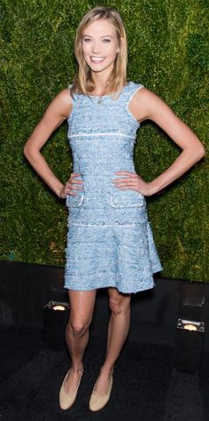Karlie Kloss gave a smile at the Chanel artists dinner held during the 2015 Tribeca Film Festival in a spring-happy sky blue tweed Chanel dress with nude Chanel ballet flats.