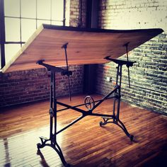 Love!! Definitely want to DIY a drafting table like this. http://farmhausmodern.com/