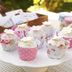 Make your own cupcake wrappers from two-sided wrapping paper. Pattern included.  Cleverly easy way to customize your party cupcakes.