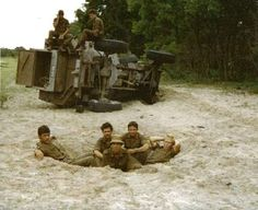 """colonel-kurtz-official: """"South African infantry in the hole left behind by a landmine their overturned Buffel APC set off. All were unharmed, the Buffel's mine resistant design performing admirably. Army Day, Defence Force, Army Vehicles, All Nature, Red Army, Military Life, African History, Armed Forces, Historical Photos"""