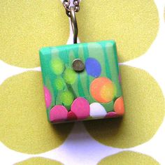 lollipop garden pendant by saltandpaper, via Flickr    I really like how the bale was made