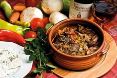 A family feast: slow-cooked 'zigouri' lamb in the pot. Maybe it is the property of its material, as even the simplest food can be transformed into the yummiest 'meze' if cooked in this fire resistant ceramic pot.