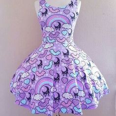 Purple kawaii dress with rainbows clouds and black moons