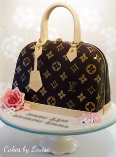 A life sized replica of a Louis Vuitton Alma PM handbag. Third one of these I've done now and each time I forget just how long those symbols take to paint….!! :O