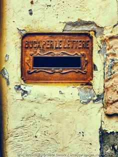Rusty Italian mailbox on a cracked, decayed white wall - ©Silvia Ganora Photography - All Rights Reserved  #bookcovers #mailbox #italian #italy #decay