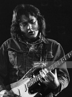 Irish musician Rory Gallagher (1948-1995) performs live on stage in Rotterdam, Netherlands in 1974.