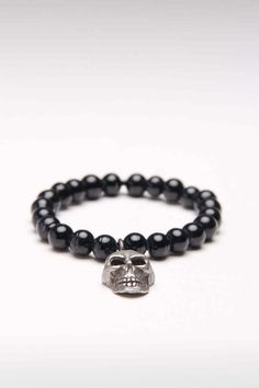 GLASS BEAD BRACELET WITH SKULL CHARM.... I fing love this!!!